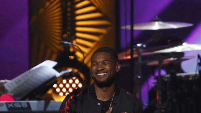 "Singer Usher performs ""Lady (You Bring Me Up)"" at the 2016 MusiCares Person of the Year gala in Los Angeles"