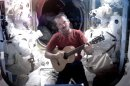 This image provided by NASA shows astronaut Chris Hadfield recording the first music video from space Sunday May 12, 2013. The song was his cover version of David Bowie&#039;s Space Oddity. Hadfield and astronaut Thomas Marshburn are scheduled to return to earth Monday May 13, 2013. (AP Photo/NASA, Chris Hadfield)