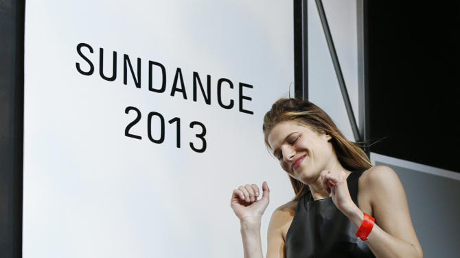 """Director, writer and cast member Lake Bell celebrates as she comes on stage to accept her U.S. Dramatic Waldo Salt Screenwriting Award for """"In A World..."""" during the 2013 Sundance Film Festival Awards Ceremony on Saturday, Jan. 26, 2013 in Park City, Utah. (Photo by Danny Moloshok/Invision/AP)"""
