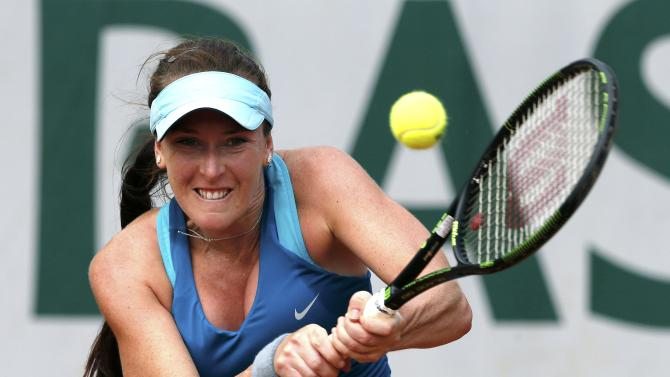 Madison Brengle of the U.S. plays a shot to Samantha Stosur of Australia during their women's singles match at the French Open tennis tournament at the Roland Garros stadium in Paris