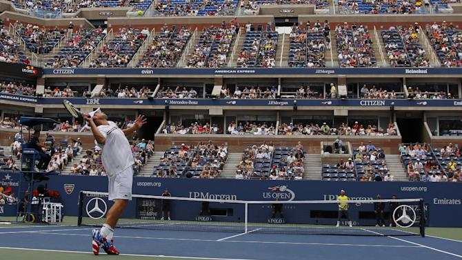 Andy Roddick serves to Italy's Fabio Fognini in the third round of play at the 2012 US Open tennis tournament,  Sunday, Sept. 2, 2012, in New York. (AP Photo/Mel C. Evans)