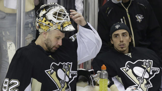 Pittsburgh Penguins goalie Tomas Vokoun (92) takes a timeout back at his bench with Pittsburgh Penguins goalie Marc-Andre Fleury, right, in the third period of Game 1 of an NHL hockey Stanley Cup second-round playoff series against the Ottawa Senators in Pittsburgh Tuesday, May 14, 2013. The Penguins won 4-1. (AP Photo/Gene J. Puskar)