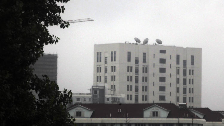"""This May 31, 2013 photo shows the building housing """"Unit 61398"""" of the People's Liberation Army, center top, in the outskirts of Shanghai, China. After years of quiet and largely unsuccessful diplomacy, the U.S. has brought its persistent computer-hacking problems with China into the open, delivering a steady drumbeat of reports accusing Beijing's government and military of computer-based attacks against America. Officials say the new strategy may be having some impact. (AP Photo)"""