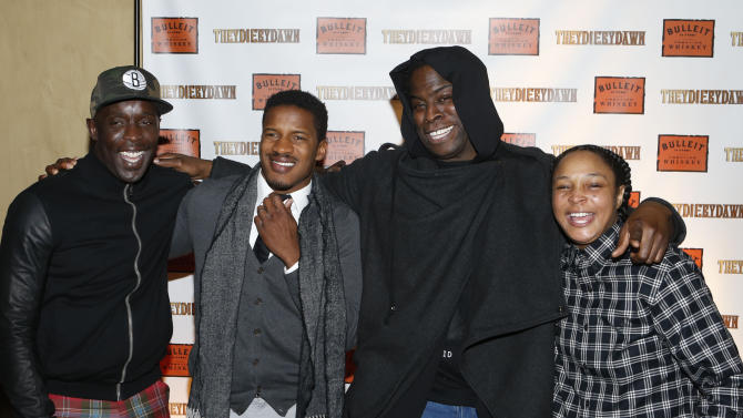 """IMAGE DISTRIBUTED FOR BULLEIT BOURBON - From left, actors Michael K. Williams, Nate Parker, director Jeymes Samuel and actress Felicia Pearson pose together at the Bulleit Bourbon presents """"They Die By Dawn"""" film screening, Tuesday, March 19, 2013 in New York. (Photo by Jason DeCrow/Invision for Bulleit Bourbon/AP Images)"""
