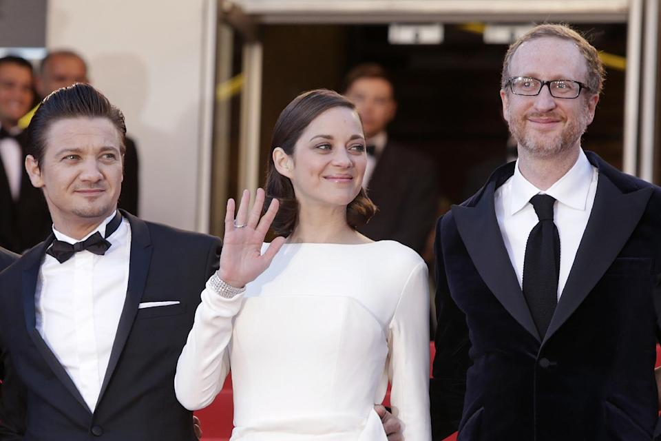 From left, actors Jeremy tenner, Marion Cotillard and director James Gray arrive for the screening of the film The Immigrant at the 66th international film festival, in Cannes, southern France, Friday, May 24, 2013. (Photo by Joel Ryan/Invision/AP)