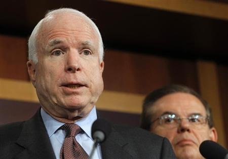Senator John McCain (R-AZ) (L) speaks while Senator Robert Menendez (D-NJ) listens during a news conference on comprehensive immigration reform at the U.S. Capitol in Washington January 28, 2013. REUTERS/Gary Cameron