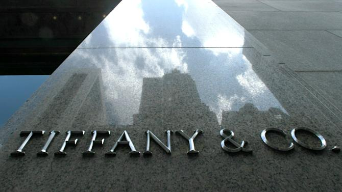 FILE - In this Aug. 26, 2010 file photo, the iconic Tiffany and Co. sign stands out on its 5th Avenue store in New York. On Tuesday, May 29, 2013, Tiffany & Co. says its first-quarter net income rose 3 percent as sales improved across all regions. The results beat Wall Street expectations, and its shares rose 6 percent in premarket trading (AP Photo/Bebeto Matthews, File)