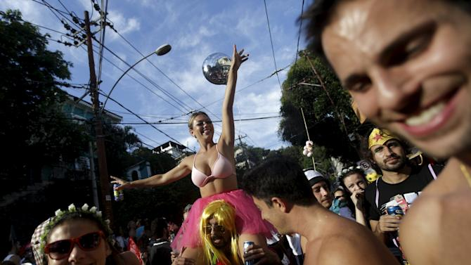 "Revellers take part in an annual block party known as ""Ceu na Terra"" (Heaven on Earth), one of the many carnival parties to take place in the neighbourhoods of Rio de Janeiro"