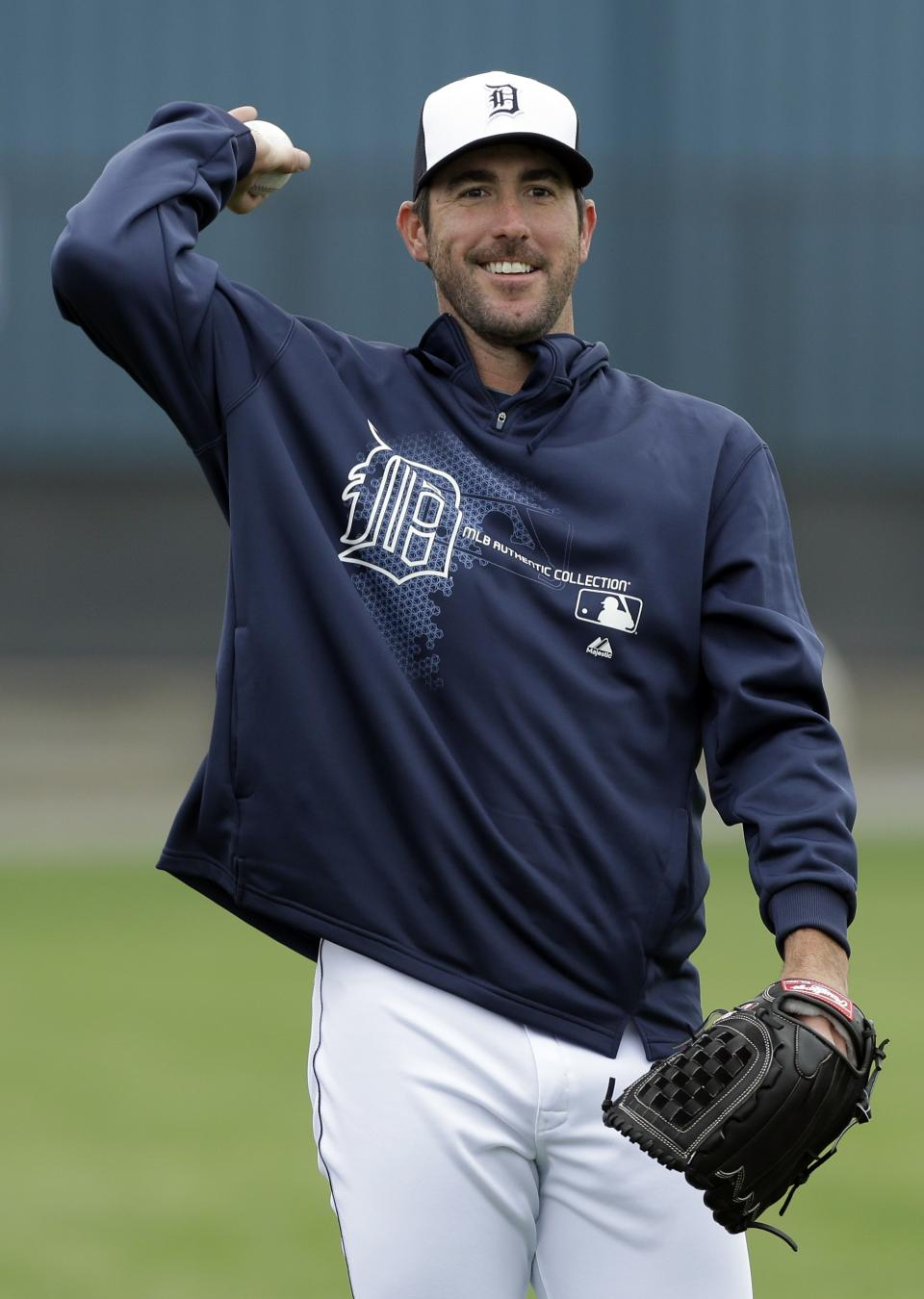 FILE - In this Feb. 15, 2013 file photo, Detroit Tigers starting pitcher Justin Verlander throws the ball during a baseball spring training workout in Lakeland, Fla. Verlander has agreed to a five-year contract covering 2015-19. (AP Photo/Charlie Neibergall, File)