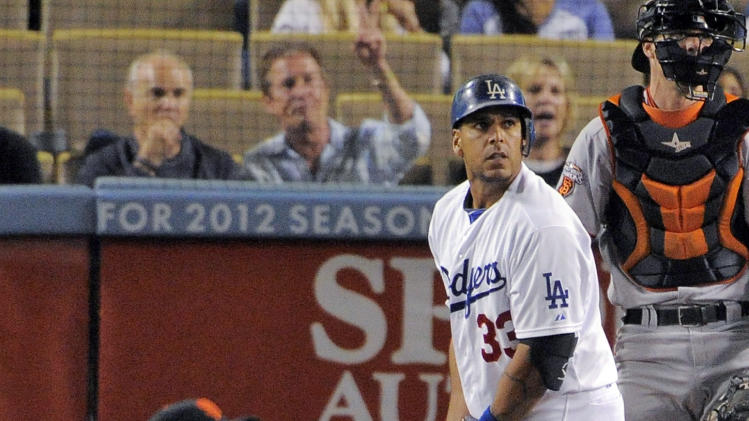 Los Angeles Dodgers' Juan Rivera, center, watches his two-run home run along with San Francisco Giants starting pitcher Madison Bumgarner, left, and catcher Chris Stewart during the first inning of a baseball game, Thursday, Sept. 22, 2011, in Los Angeles. (AP Photo/Mark J. Terrill)