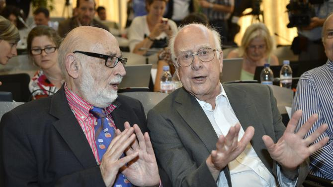 "Belgian  physicist  Francois Englert, left, and British physicist Peter Higgs right, answers journalist's question about the scientific seminar to deliver the latest update in the search for the Higgs boson at the European Organization for Nuclear Research (CERN) in Meyrin near Geneva, Switzerland, Wednesday, July 4, 2012. The head of the world's biggest atom smasher is claiming discovery of a new particle that he says is consistent with the long-sought Higgs boson known popularly as the ""God particle.""  Rolf Heuer, director of the European Center for Nuclear Research, or CERN, says ""we have a discovery"" of a new subatomic particle, a boson, that is ""consistent with a Higgs boson.""  He spoke after two independent teams at CERN said they have both ""observed"" a new boson that looks just like the one believed to give all matter in the universe size and shape.  (AP Photo/Keystone/Martial Trezzini)"