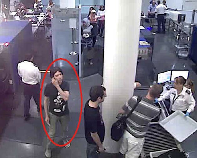 This surveillance image provided by Interpol shows who authorities believe is Luka Rocco Magnotta at a security checkpoint area. A state prosecutor says police are investigating two claimed French cap