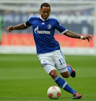Schalke's midfielder Jermaine Jones plays the ball during their German first division Bundesliga football match against Augsburg in Gelsenkirchen, western Germany. Schalke won the match 3-1
