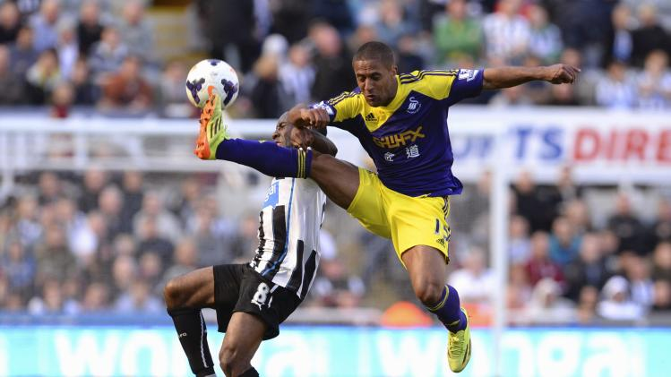 Swansea City's Routledge challenges Newcastle United's Anita during their English Premier League soccer match at St James' Park in Newcastle