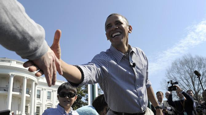 President Barack Obama shakes hands during the annual Easter Egg Roll on the South Lawn of the White House in Washington, Monday, April 1, 2013. (AP Photo/Susan Walsh)