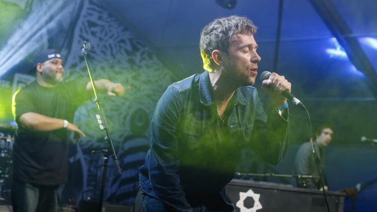 Damon Albarn, right, joined by De La Soul's Vincent Mason, left, performs during the SXSW Music Festival Friday March 14, 2014, in Austin, Texas. (Photo by Jack Plunkett/Invision/AP)