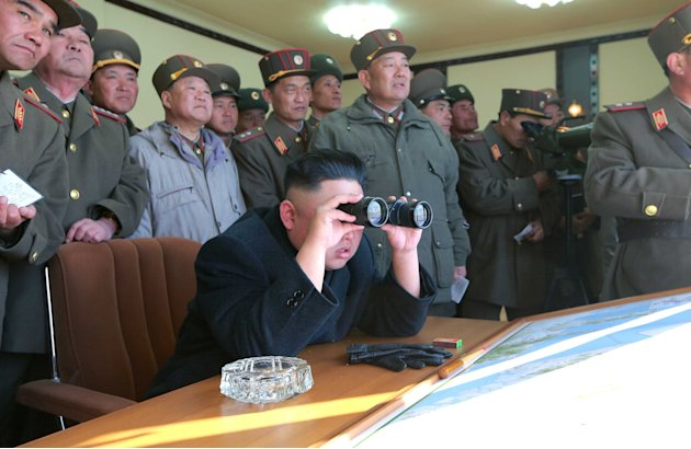 In this undated photo released by the Korean Central News Agency (KCNA) and distributed Thursday, March 14, 2013 by the Korea News Service, North Korean leader Kim Jong Un uses a pair of binoculars to
