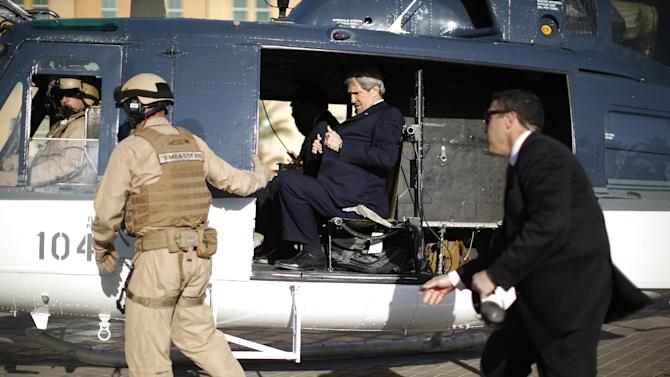 U.S. Secretary of State John Kerry straps himself into a helicopter as he prepares to fly out of the U.S. Embassy in Baghdad Sunday, March 24, 2013. Kerry was in Iraq today, meeting with officials in an unannounced visit. He says he made it clear in talks with the Iraqi Prime Minister Nouri al-Maliki that the U.S. is unhappy with Iraq for letting Iran use its airspace to ship weapons and fighters to Syria. (AP Photo/Jason Reed, Pool)