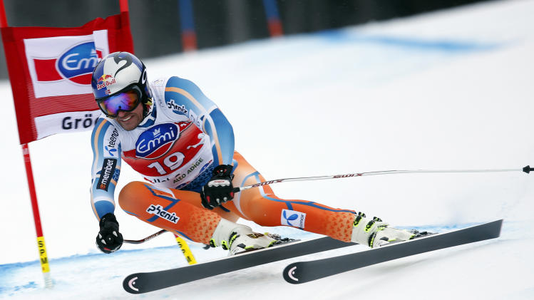 Norway's Aksel Lund Svindal speeds down the hill on his way to take first place during an alpine ski, men's ski World Cup super-G race, in Val Gardena, Italy, Friday, Dec. 20, 2013. (AP Photo/Marco Trovati)