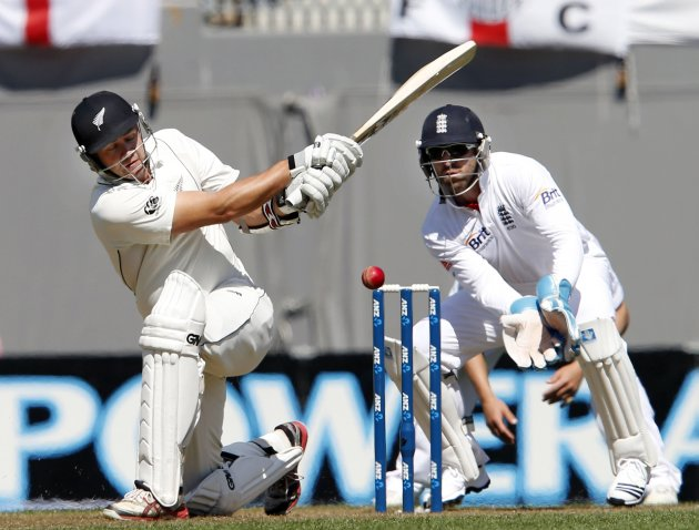 New Zealand's Peter Fulton plays a shot watched by England's Matt Prior on the first day of their final cricket test at Eden Park in Auckland