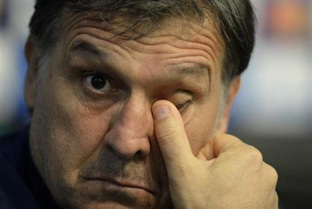 Barcelona's manager Gerardo Martino reacts during a news conference at the Etihad Stadium in Manchester, northern England, February 17, 2014. REUTERS/Nigel Roddis/Files