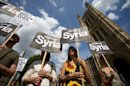 Demonstratorsa protest against potential British military involvement in Syria, in London on August 29, 2013