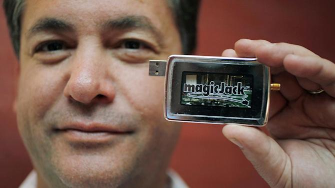 FILE - In this file photograph taken Jan. 7, 2010, magicJack CEO and founder Dan Borislow holds up the new and improved magicJack at the Consumer Electronics Show (CES) in Las Vegas. Borislow died Monday, July 21, 2014, officials at the company he founded said. He was 52. (AP Photo/Paul Sakuma, File)