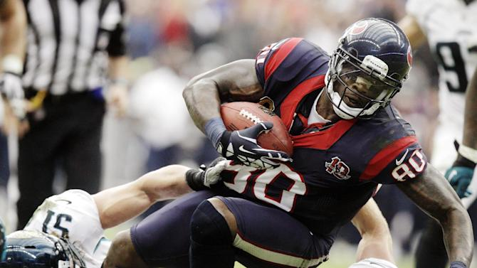 Houston Texans wide receiver Andre Johnson (80) is tackled by Jacksonville Jaguars Paul Posluszny (51) and Chris Prosinski (42) during the fourth quarter of an NFL football game, Sunday, Nov. 18, 2012, in Houston. (AP Photo/Patric Schneider)