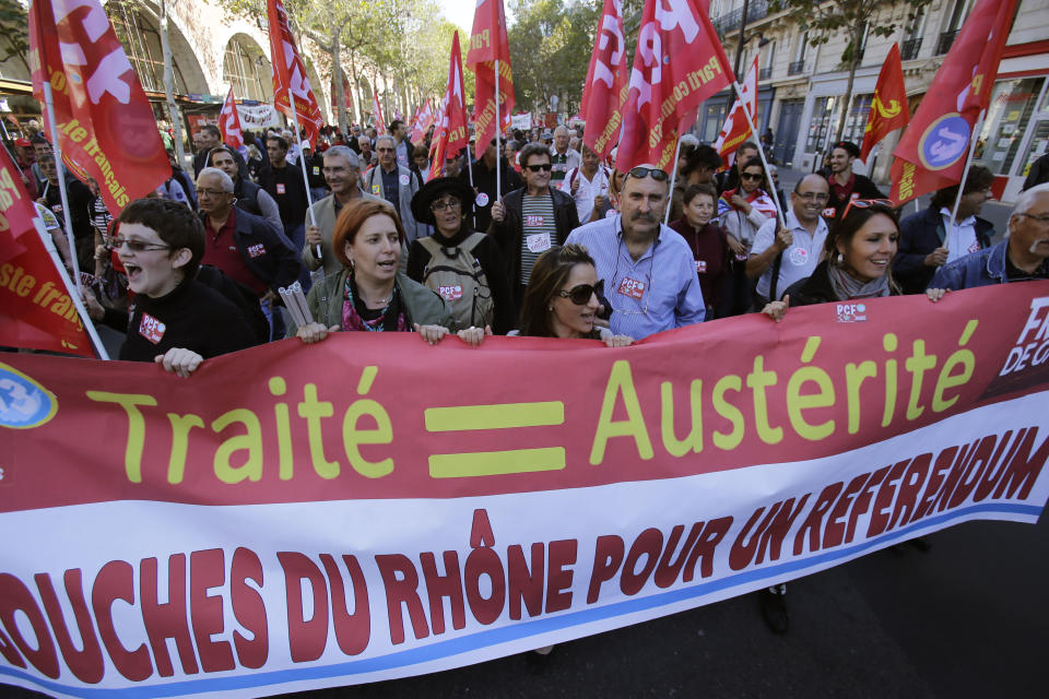 "Demonstrators march during a rally holding a banner which reads,""treaty equal austerity, Bouches du Rohne region for a referendum"", to protest against the austerity measures announced by the French government, in Paris, Sunday, Sept 30, 2012. (AP Photo/Michel Euler)"