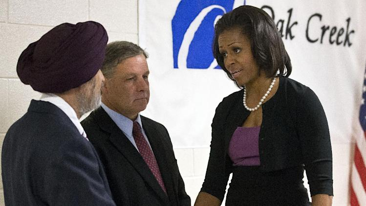 First lady Michelle Obama greets  Sikh temple secretary of the board of trustees Kulwant Singh Dhaliwal, left, and Oak Creek, Wis. Mayor Stephen Scaffidi, before talking to victims of the August 5th shooting, Thursday, Aug. 23, 2012,  in Oak Creek, Wis. (AP Photo/Morry Gash)