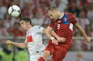 Polish forward Robert Lewandowski (L) vies with Czech defender Michal Kadlec during the Euro 2012 championships football match between the Czech Republic and Poland on June 16, 2012 at the Municipal  Stadium in Wroclaw. AFP PHOTO / JANEK SKARZYNSKI