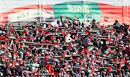Emirati fans cheer their team prior to the start of United Arab Emirates semi final match against Kuwait in the 21st Gulf Cup in Manama, on January 15, 2013. Iraq will take on the United Arab Emirates in the final of the 21st Gulf Cup on Friday after both sides -- the only two of eight in the tournament to be coached by locals -- advanced through the group stage undefeated
