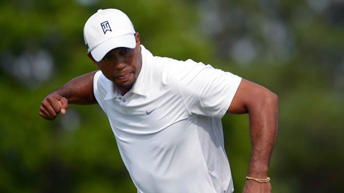 Tiger Woods pumps his fist after making a putt for eagle on the 16th green during the third round of the Arnold Palmer Invitational golf tournament in Orlando, Fla., Saturday, March 23, 2013. (AP Photo/Phelan M. Ebenhack)