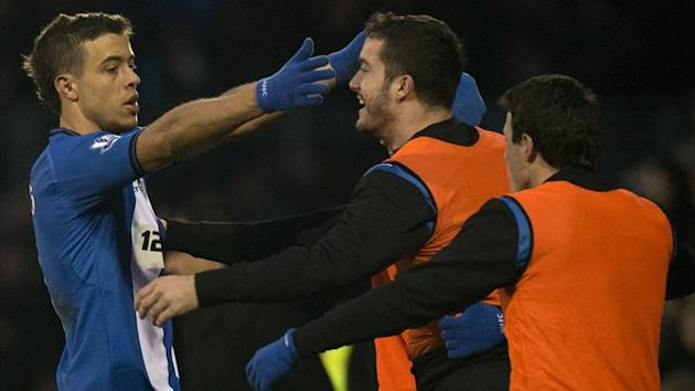 Wigan Athletic's Argentine forward Franco Di Santo (L) celebrates after scoring the equalising goal at Fulham (AFP)