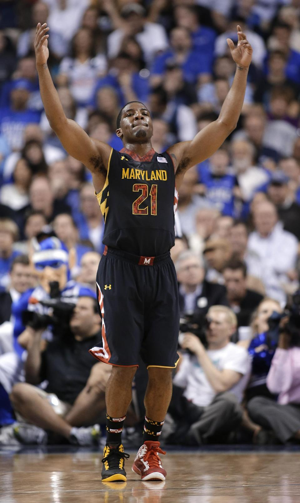 Maryland's Pe'Shon Howard gestures in the final seconds of an NCAA college basketball game against Duke at the Atlantic Coast Conference men's tournament in Greensboro, N.C., Friday, March 15, 2013. Maryland won 83-74. (AP Photo/Bob Leverone)