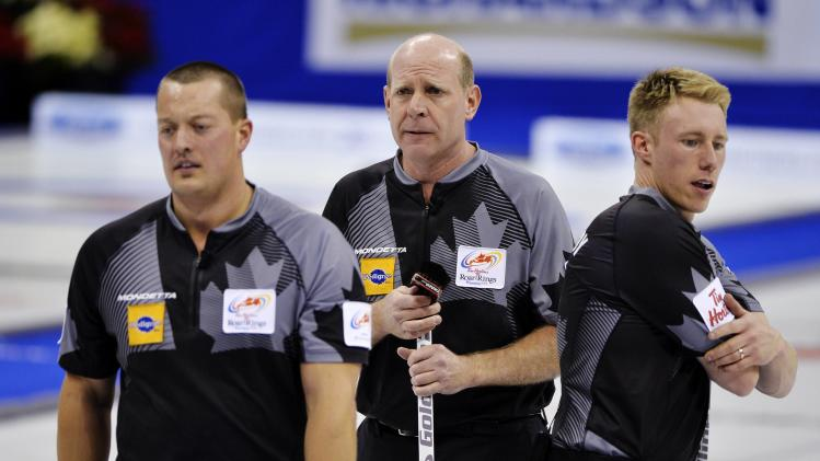 Team Martin reacts to a missed shot against Team Morris during the men's semi-final at the Roar of the Rings Canadian Olympic Curling Trials in Winnipeg