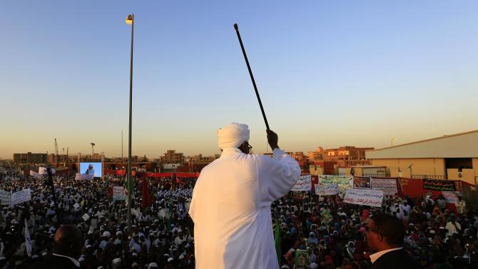Sudanese President Omar Hassan al-Bashir addresses the crowd during a rally with Sufi supporters in Hajj Yusuf at Khartoum district