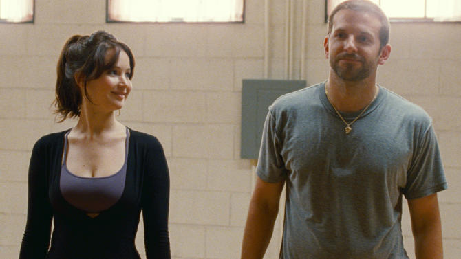 """This film image released by The Weinstein Company shows Jennifer Lawrence, left, and Bradley Cooper in """"Silver Linings Playbook."""" (AP Photo/The Weinstein Company, JoJo Whilden)"""