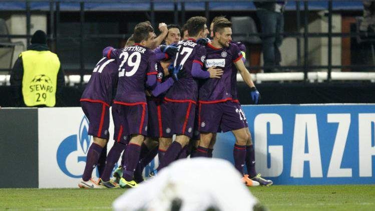 Austria Vienna players celebrate after scoring against Zenit St Petersburg during their Champions League soccer match in Vienna