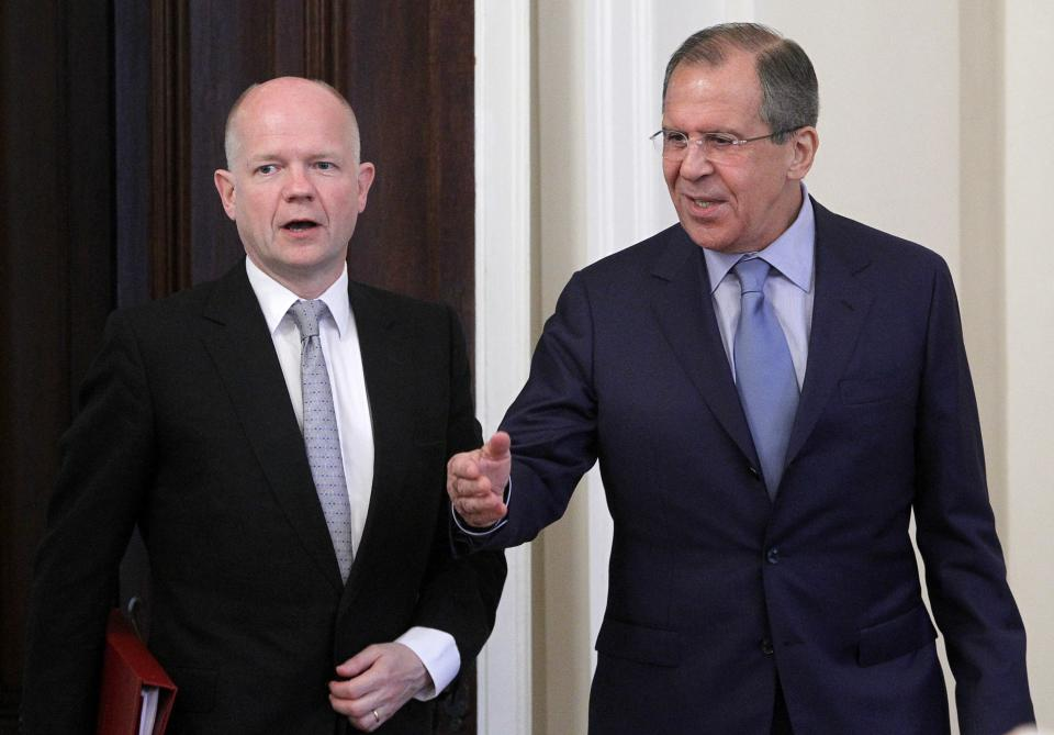 Russian Foreign Minister Sergey Lavrov, right, welcomes his British counterpart William Hague during their meeting in Moscow, Russia, Monday, May 28, 2012 , expected to focus on the Syria crisis. (AP Photo/Misha Japaridze)