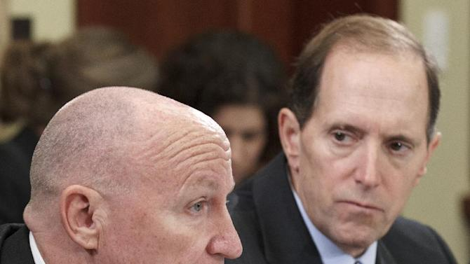 FILE - In this Feb. 1, 2012 file photo, House Ways and Means Committee member, Rep. Kevin Brady, R-Texas, left, makes a comment during a meeting of the Payroll Tax conferees, on Capitol Hill in Washington. A temporary reduction in Social Security payroll taxes is due to expire at the end of the year and hardly anyone in Washington is pushing to extend it. Neither Obama nor Romney has proposed an extension, and it probably wouldn't get through Congress anyway, with lawmakers in both parties down on the idea. House Ways and Means Committee Chairman Rep. David Camp, R-Mich. listens at right. (AP Photo/J. Scott Applewhite, File)
