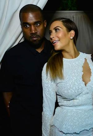 Kanye West and Kim Kardashian attend DuJour Magazine's event to honor artist Marc Quinn at Delano Beach Club on December 4, 2013 in Miami Beach, Florida -- Getty Images