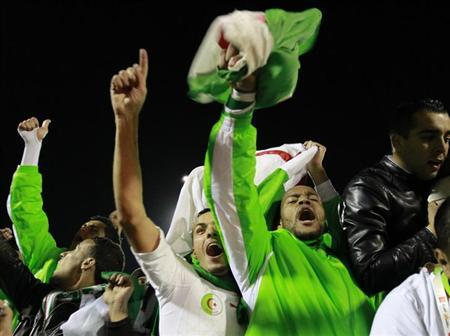 Algeria's Rais Mbolhi (2nd R) and Fouad Kadir celebrate after winning their 2014 World Cup qualifying second leg playoff soccer match against Burkina Faso at Tchaker Stadium in Blida, November 19, 201