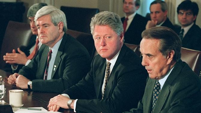 FILE –  In this Dec. 29, 1995, file photo President Clinton meets with Republican congressional leaders, Senate Majority Leader Bob Dole of Kansas, right, and House Speaker Newt Gingrich, second from left, at the White House to discuss the federal budget impasse. Treasury Secretary Robert Rubin is partially visible at left. President Barack Obama and his officials are doing their best to drum up public concern over the shock wave of spending cuts that could strike the government in just days. So it's a good time to be alert for sky-is-falling hype. (AP Photo/Wilfredo Lee, File)