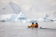 In this Dec. 3, 2009 photo provided by Aurora Expeditions, tourists paddle their kayak along the Antarctic Peninsula. In a remote, frozen, almost pristine land where the only human residents are involved in research, tourism comes with risks, for both the continent and the tourists. (AP Photo/Aurora Expeditions, Andrew Halsall) EDITORIAL USE ONLY