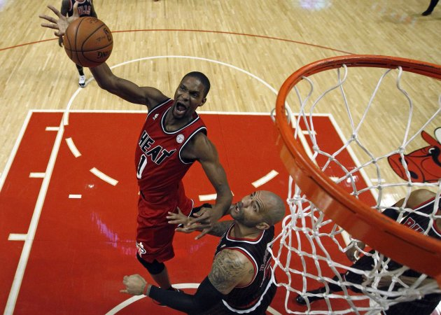 Miami Heat's Bosh goes to the basket over Chicago Bulls' Boozer during the first half of their NBA basketball game in Chicago, Illinois