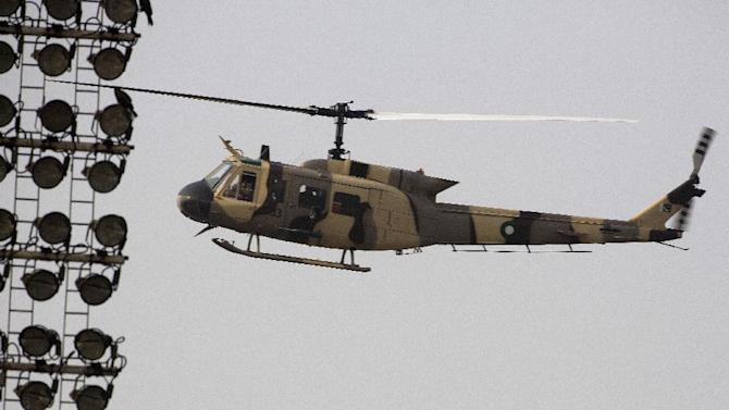 A helicopter flies over the Gaddafi stadium for security surveillance before a match between Pakistan and Zimbabwe in Lahore, Pakistan, Friday, May 22, 2015.  Thousands of police were on duty at a Pakistani cricket stadium on Friday as cricket fans prepared for the first international game since a terror attack in 2009. (AP Photo/B.K. Bangash)