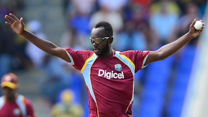 West Indies bowler Nikita Miller celebrates after catching the wicket during a One Day International match between West Indies and England in St John's on March 5, 2014