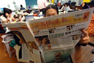 A man reads Min Sheng Daily in Taipei, 29 November 2006, there is growing concern that recent media deals could create a pro-China media monopoly in the country.Taiwan&#39;s main opposition party will stage a huge demonstration against the government&#39;s economic record