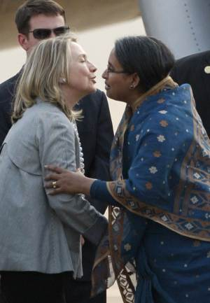 U.S. Secretary of State Hillary Rodham Clinton, left, is greeted by Bangladeshi Foreign Minister Dipu Moni upon her arrival in Dhaka, Bangladesh, Saturday, May 5, 2012. Clinton is in Bangladesh to press tolerance, democracy and development in one of the world's most impoverished nations that is now in the throes political turmoil. (AP Photo/Pavel Rahman)